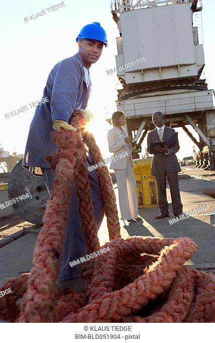 African American manual worker pulling rope