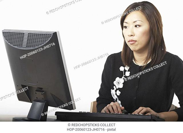 Close-up of a businesswoman using a computer