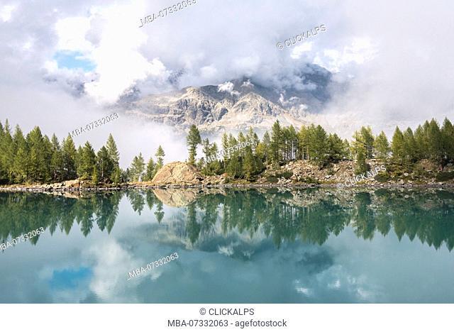 A glimpse into the clouds at Lago Lagazzuolo, Chiesa in Valmalenco, Province of Sondrio, Valtellina, Lombardy, Italy Europe