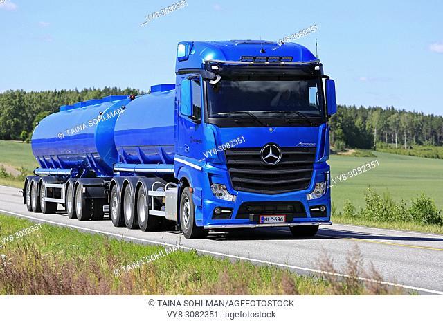 Blue Mercedes-Benz Actros tank truck of Kuljetusliike Markus Hanninen Oy hauls load along highway on sunny day of summer. Salo, Finland - July 1, 2018