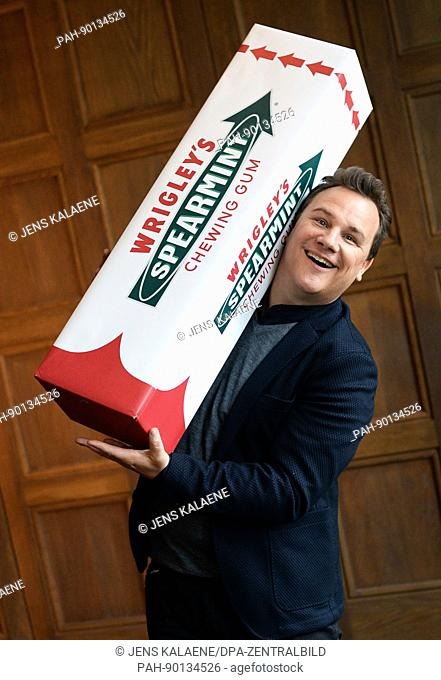 Fashion designer Guido Maria Kretschmer poses with an oversized pack of gums during the presentation of an XXL rucksack designed by him for Wrigleys Spearmint...