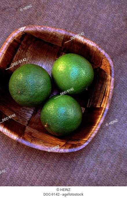 In a lay wood bowl of three limes limes have a high c-vitamin content