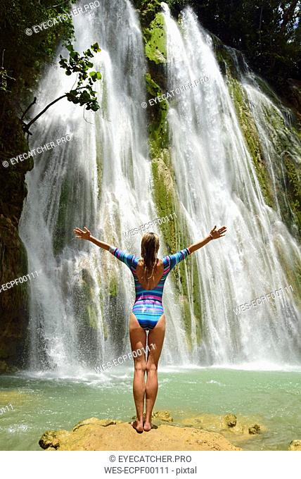 Dominican Republic, Samana, woman admiring huge waterfall