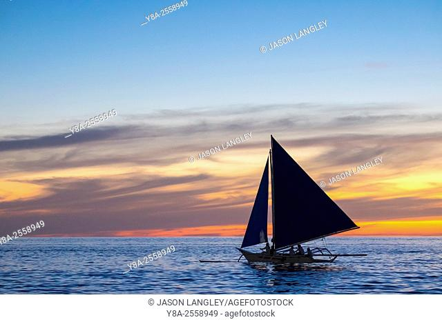 Sailboat at sunset on White Beach, Boracay Island, Aklan Province, Western Visayas, Philippines