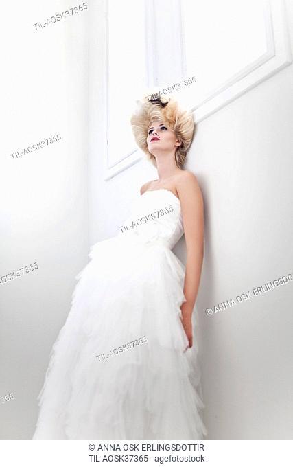 Lone female figure in white wedding dress