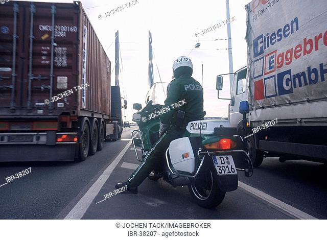 DEU, Germany, Duesseldorf : Police bike patrol. Traffic control during rushhour