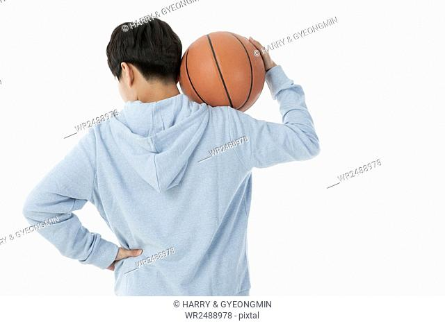 Back of teenager boy with a basketball