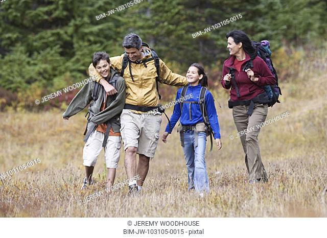 Family hiking through dry field