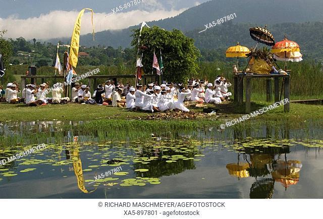 Traditional ceremony at Danau Bratan near Pura Ulun Danu Bratan, Bali, Indonesia