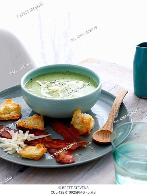 Bowl of caesar salad soup with croutons