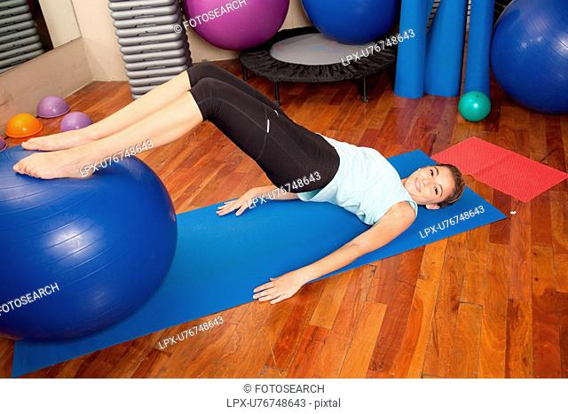 Woman stretching with a ball