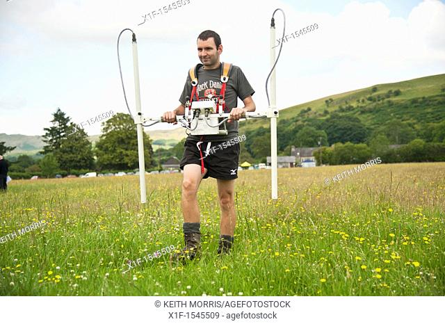 An archaeologist undertaking a geophysical survey of a likely excavation site at Strata Florida Abbey, Mid wales UK