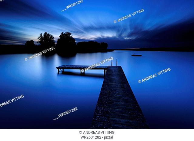 Small lake with footbridge, Mecklenburg Lakeland, Mecklenburg-Western Pomerania, Germany