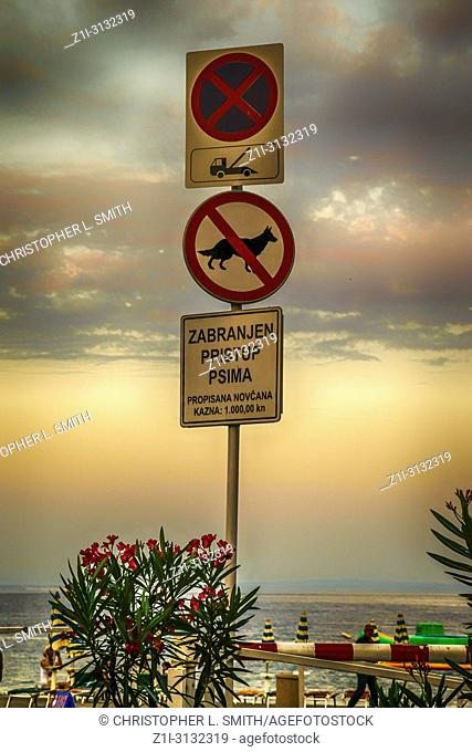 Sign clearly showing towaway zone, no dogs and a fine of 10,000kn in Opatija, Croatia
