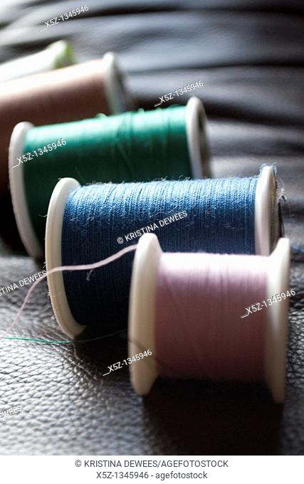 Several rolls of different colored thread