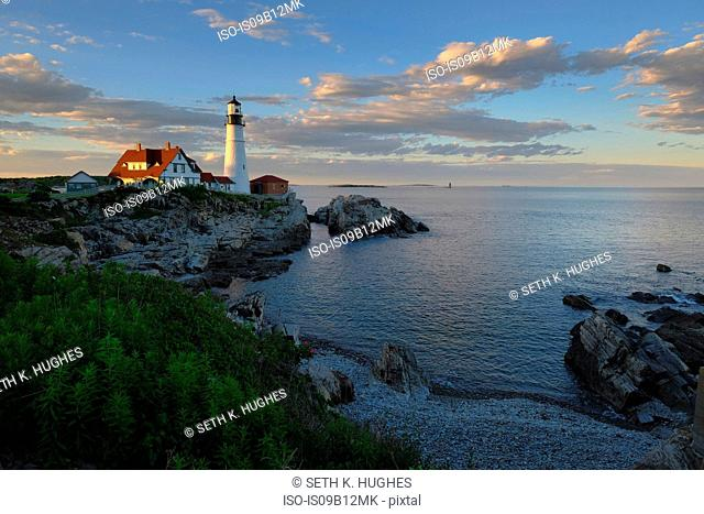 Lighthouse on cliff by ocean, Cape Elizabeth, Portland, Maine, USA