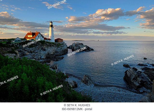 Lighthouse on cliff by ocean, Cape Elizabeth, Portland, Maine, USA
