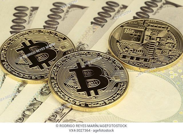 Virtual currency Golden Bitcoins on 10,000 Japanese Yen bills. (Photo by Rodrigo Reyes Marin)