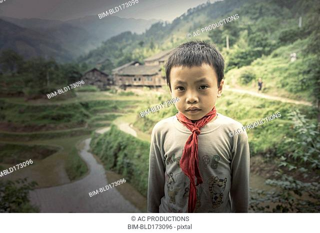 Chinese boy standing in rice paddy fields