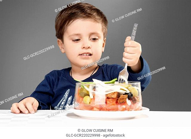 Boy eating fruit salad