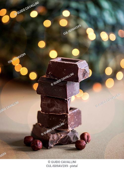 Stack of chocolate blocks with hazelnuts