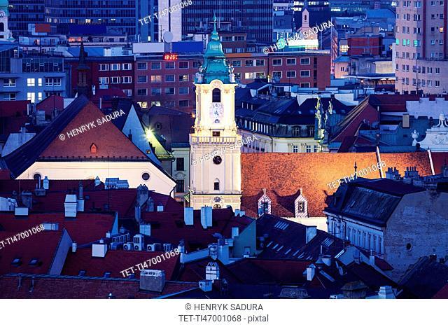 Clock tower among buildings