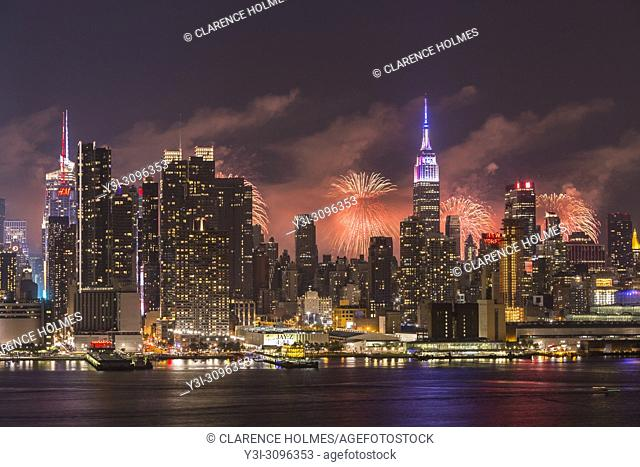 WEEHAWKEN, NJ - JULY 4: The annual Macy's Fourth of July fireworks show lights the sky behind the Manhattan skyline on Tuesday, July 4
