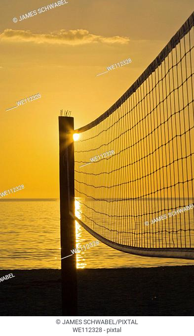 Volleyball net silhouetted aganist sunset sky on Venice Beach Florida