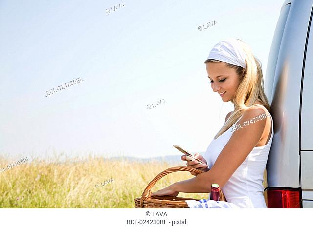 portrait of young woman looking at her mobile phone