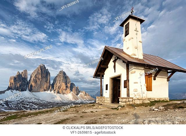 The alpine church near the refuge Locatelli. In the background the Three Peaks under a blue sky. Europe, Italy, South Tyrol, Bolzano, Dolomites