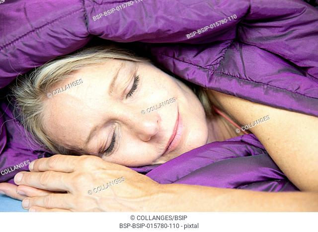 Woman sleeping in a duvet