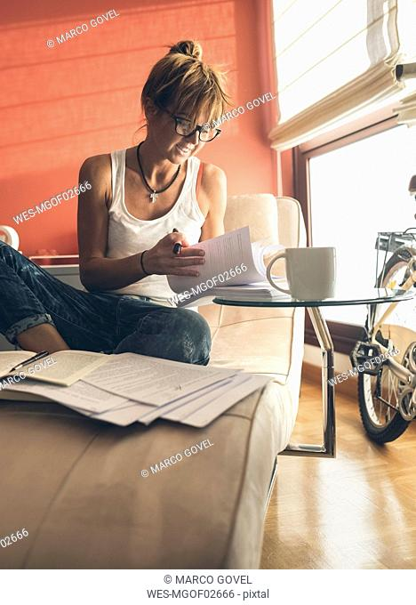 Woman at home working on script