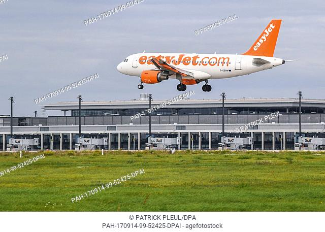 A passenger plane of the British low-cost carrier easyJet lands on the southern runway of the Berlin Brandenburg Airport (BER) by Schoenefeld, Germany