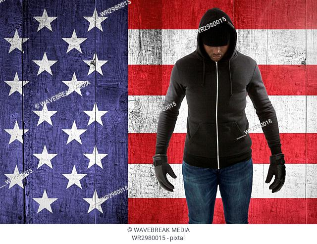 man with covered face against american flag