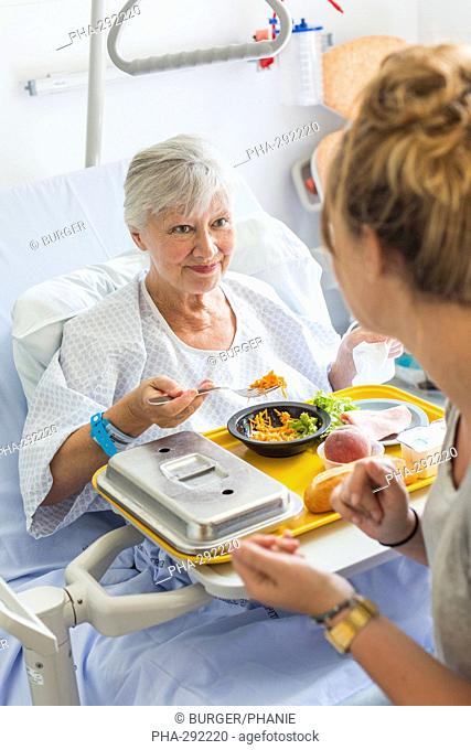 Hospitalized woman having lunch