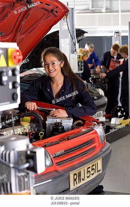 Student repairing car in automotive vocational school