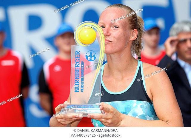 The Dutch tennis player Kiki Bertens kisses the Tournament cup after her win against Colombian Duque-Marino during the WTA tennis tournament in Nuremberg