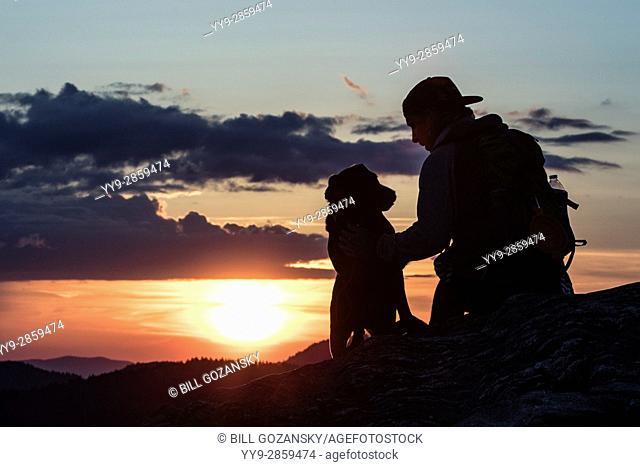 Hiker with dog at sunset on Art Loeb Trail near Black Balsam Knob - Blue Ridge Parkway, North Carolina, USA