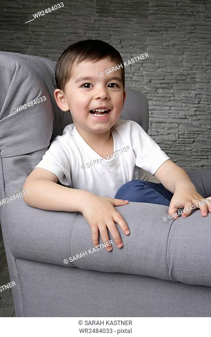 Little boy on sofa