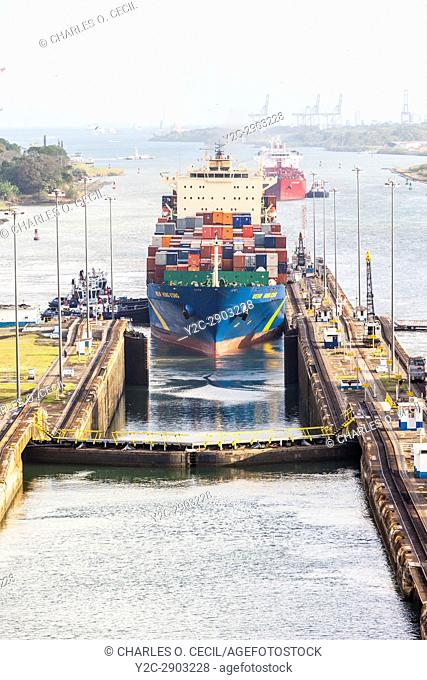 Panama Canal, Panama. Container Ship Wehr Hong Kong Approaching First Lock on Caribbean Side