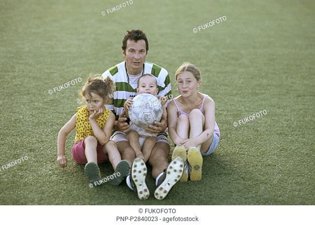 Dad with kids on soccer field