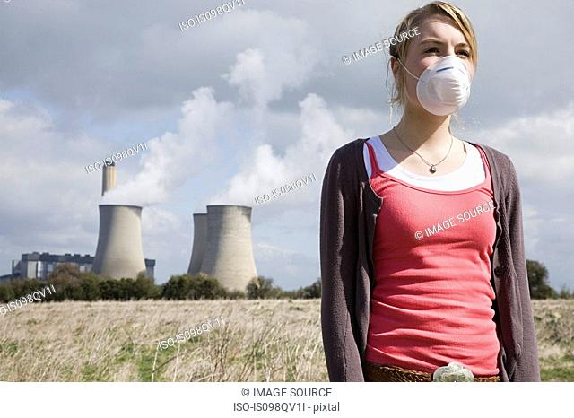 Girl in mask by power station