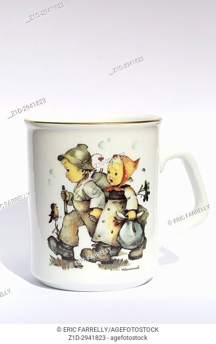 Goebel Hummel products. Cup with Hansel and Gretel painted on side of cup