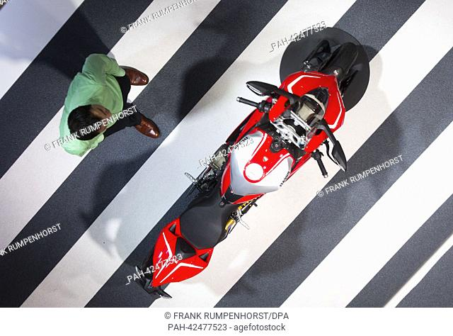 A motorcycle of the model Ducati Corse is reflected in a mirror of the ceiling of a booth of Audi at the Frankfurt Motor Show IAA in Frankfurt/Main, Germany