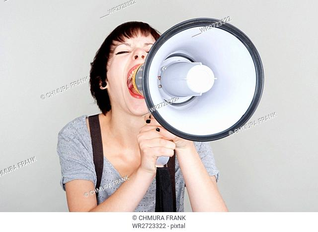 angry, announce, announcement, attractive, background, bullhorn, Caucasian, communication, concept, expression, female, girl, holding, isolated, loud