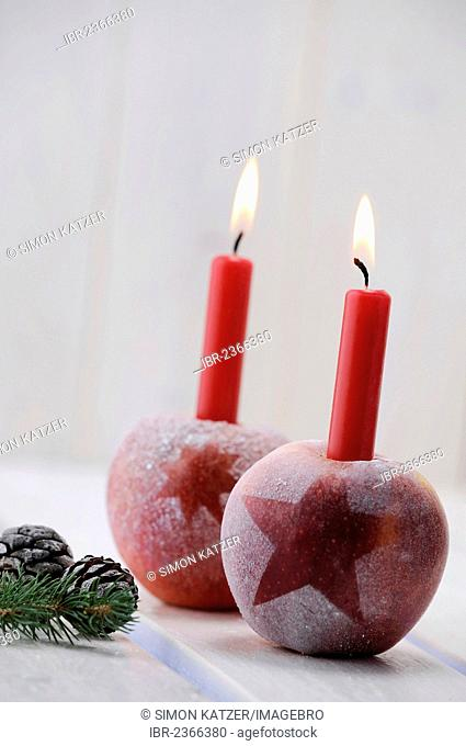 Christmas ambience with red apples and candles