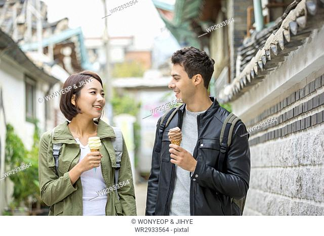 Portrait of young smiling couple tourists