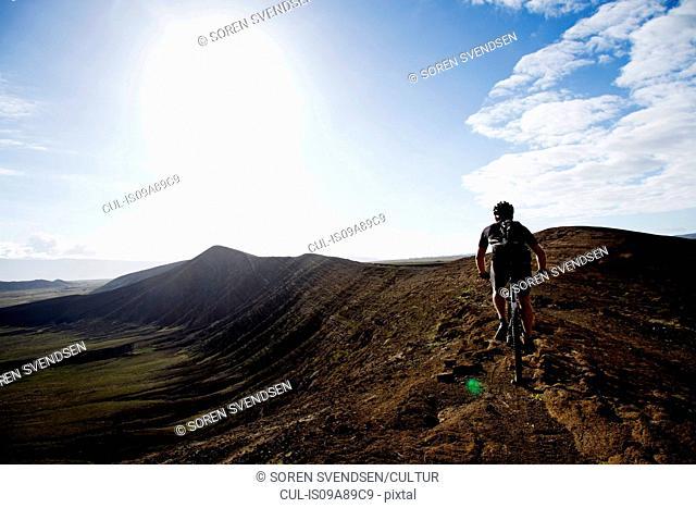Man mountain biking, Caldera del Cuchillo, Lanzarote