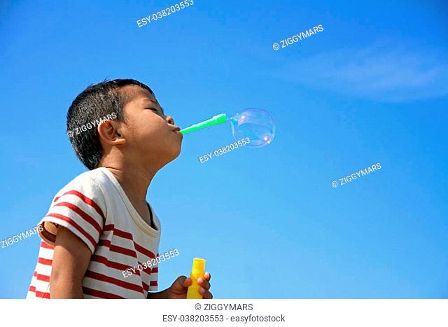 Japanese boy blowing bubbles