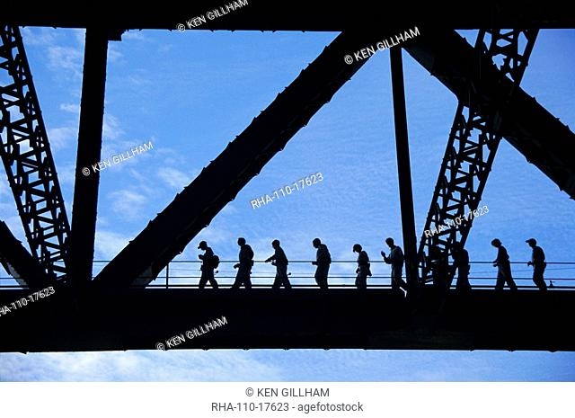 Bridge climb participants in silhouette, Sydney Harbour Bridge, Sydney, New South Wales, Australia, Pacific